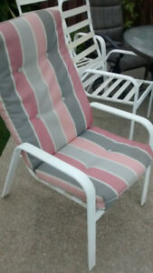 Six White patio chairs with cushions