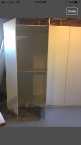 IKEA shelving unit with doors and 4 shelves.