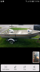 12 foot boat, motor, trailer.