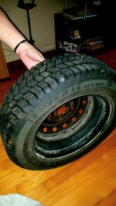 4 pneus 14 pouces avec rims a vendre