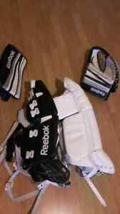 "Reebok goalie pads 23"" with matching blocker and trapper"