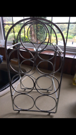 Silver metal wine rack in excellent condition.