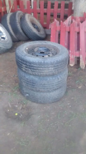 3 tires and rims for 90s ford car