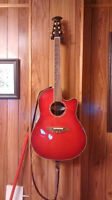 Beautiful Red Ovation acoustic guitar with plug in.