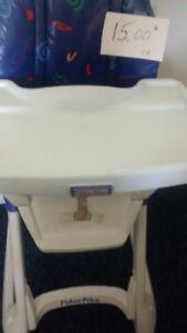 chaise haute fisher price 15$