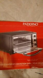 BRAND NEW! Paderno convection toaster oven!