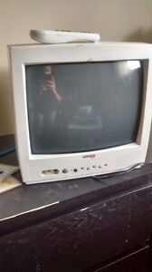 Small white TV with remote