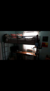 Twin size loft bed frame and built in desk