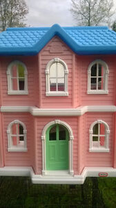 Little Tike two story doll house.