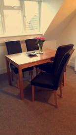Dining table and 4 faux leather chairs (hardly used, like new)