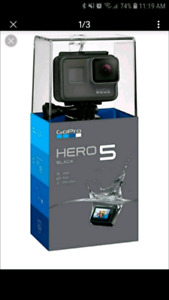 Go pro hero 5 black and lots of attachments