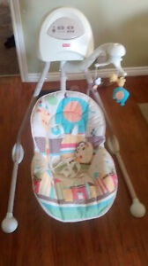Baby seat swing with mobile attached