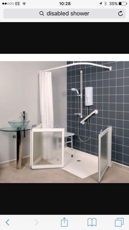 Disabled shower, chair and rail.