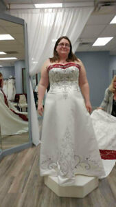 Wedding dress never worn other than to try on. Never altered.