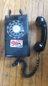 vintage wall-mount rotary phone