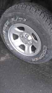 """Cooper AT t3 mounted on 17"""" stock dodge Ram rims"""