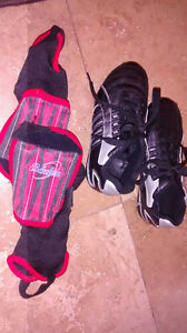 Kid's soccer cleats and shin pads