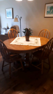 Oak pedestal table and chairs and buffet and hutch