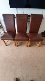 Six solid oak leather chairs