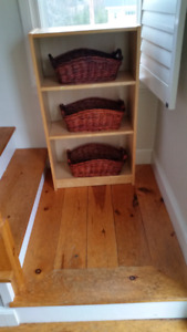 Ikea shelf with wicker bins