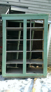Various basement shelving units and wooden storage boxes