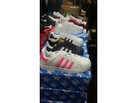 Brand new superstars trainers with box