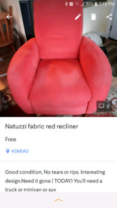 Red Natuzzi recliner chair