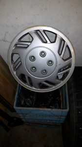 2 Sets of Tires with rims and 1 set of hubcaps