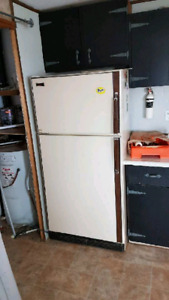 Fridge, stove and dryer for sale.