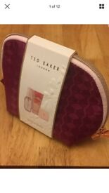 Brand new cosmetic bag with lip balm, body spray and hand cream