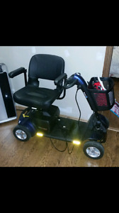 Brand new go go sport mobility scooter and 5 pd weights see ad