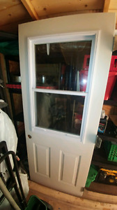 RIGHT HAND SWING 32 INCH EXTERIOR STEELDOOR WITH SLIDE UP WINDOW