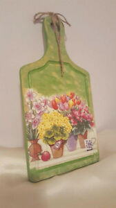 Cutting board with hand made decoupage.