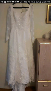 Wedding dress, veil, and tiara.
