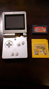 Gameboy sp. With pokemon and dragonball z