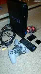 PS2 and 32 games, controller, and remote.