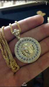 Barely worn 10k franco and Versace Pendant