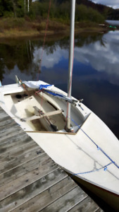 2 voiliers . Un sunfish 400$ et un cl 15 400$