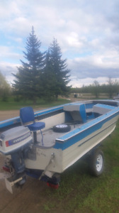 16 ft starcraft boat w/ trailer and motor  $2700
