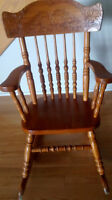 Solid oak chids rocking chair. Excellent condition.