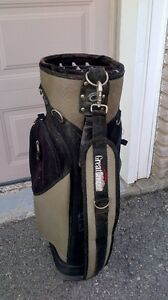 2 golf pull carts with golf bags