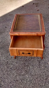 Antique solid wood coffee table with leather inlay