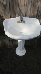 pedestal sink and waterfall faucet