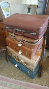 Vintage antique leather material suitcases.