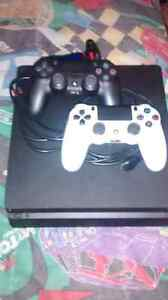 MINT COND. PS4 CONSOLE WITH 2 CONTOLLERS-$400 obo