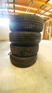 New 205 65R15 Michelin X-ice snow tires w/ steel rims.