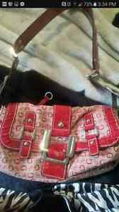Authentic guess purse and matching wallet.