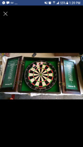 Dart board and wooden cabinet