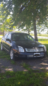 2006 Ford Fusion with set of winter tires (129,303km)