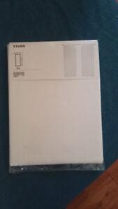 Rideaux Ikéa neufs - 1 panneau voile blanc et 1 panneau à motifs